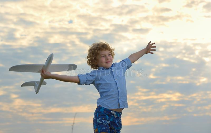 little boy holding a wooden airplane model stock images
