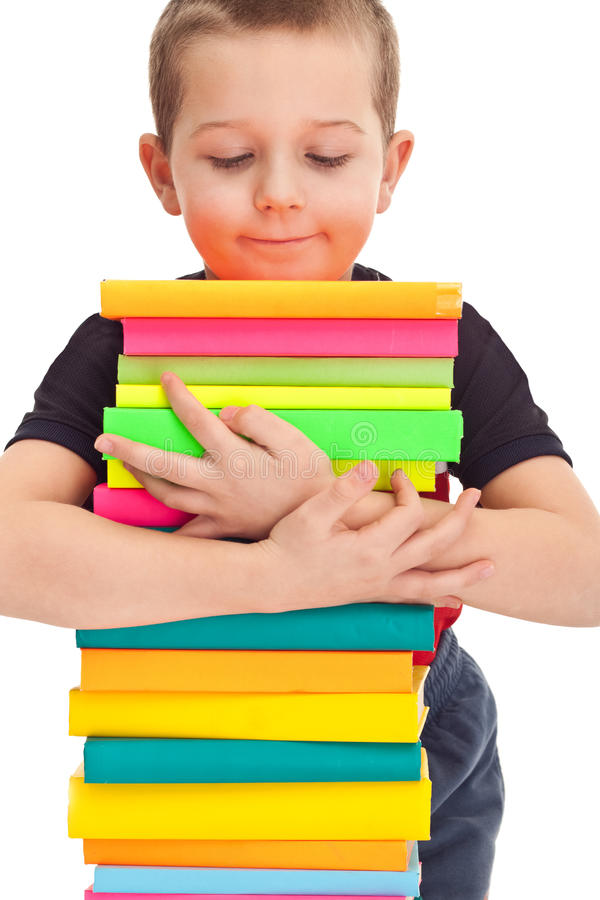 Little boy holds a stack of books royalty free stock image