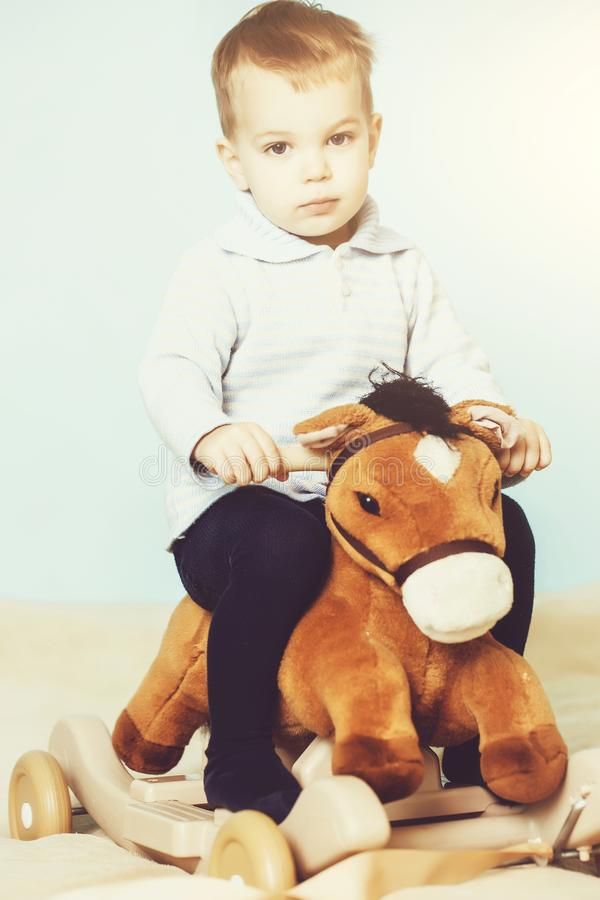 Little boy on horse toy royalty free stock images