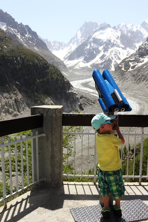 Little boy and huge Mont Blanc massif, France stock photo