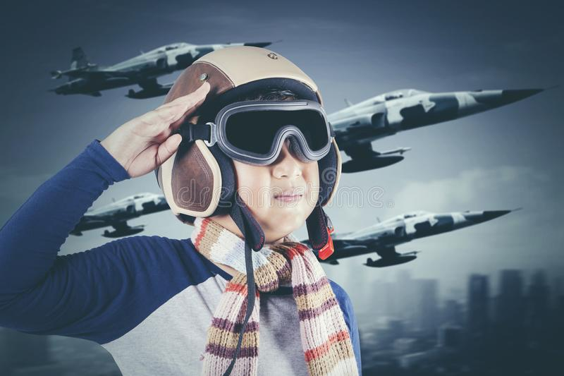 Little boy with jet plane in the sky royalty free stock image
