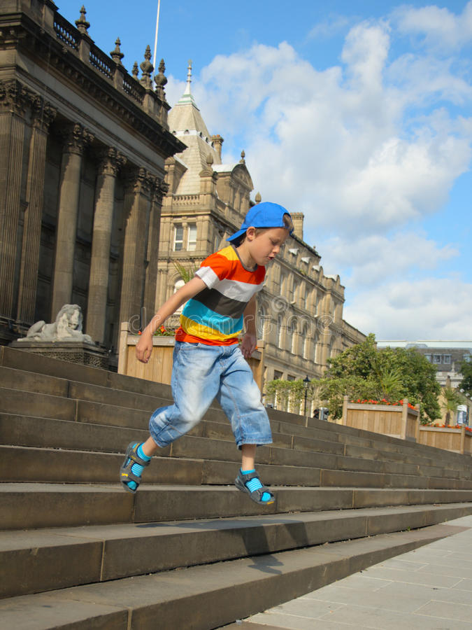 Free Little Boy Jumping From Town-hall Steps Royalty Free Stock Images - 20449159