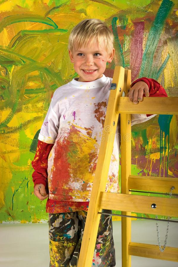 Little boy on ladder royalty free stock photos