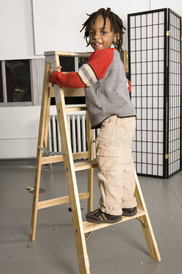 Download Little boy on a ladder stock photo. Image of humour, climbing - 521532