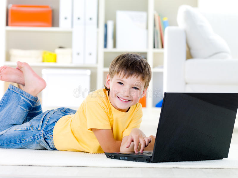 Little boy with laptop royalty free stock image