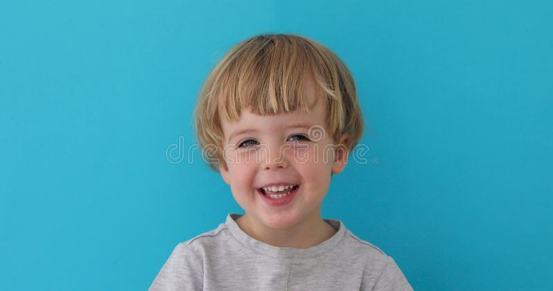 Little boy laughing at camera royalty free stock images