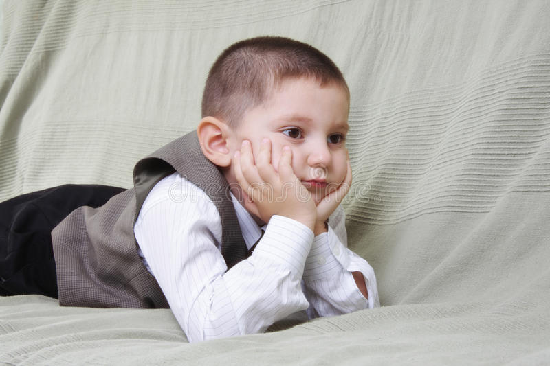 Download Little boy laying on sofa stock photo. Image of shirt - 13532826