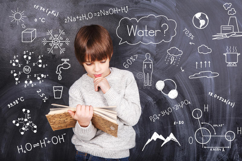 Little boy learn chemistry royalty free stock photography