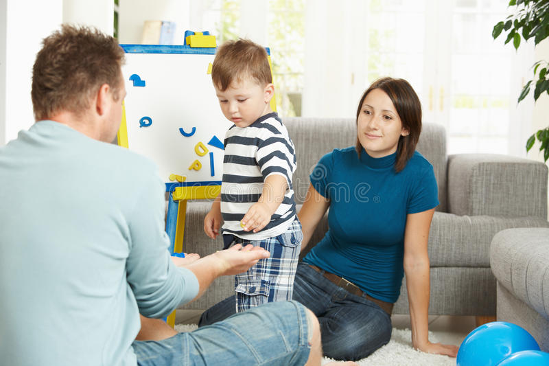 Download Little Boy Learning Letters And Numbers Stock Photo - Image of family, casual: 11279924
