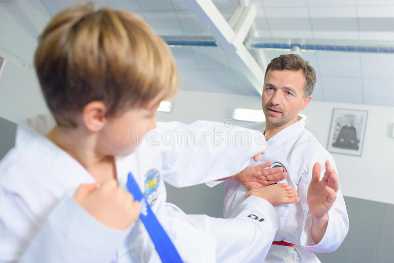 Little boy learning martial art royalty free stock images
