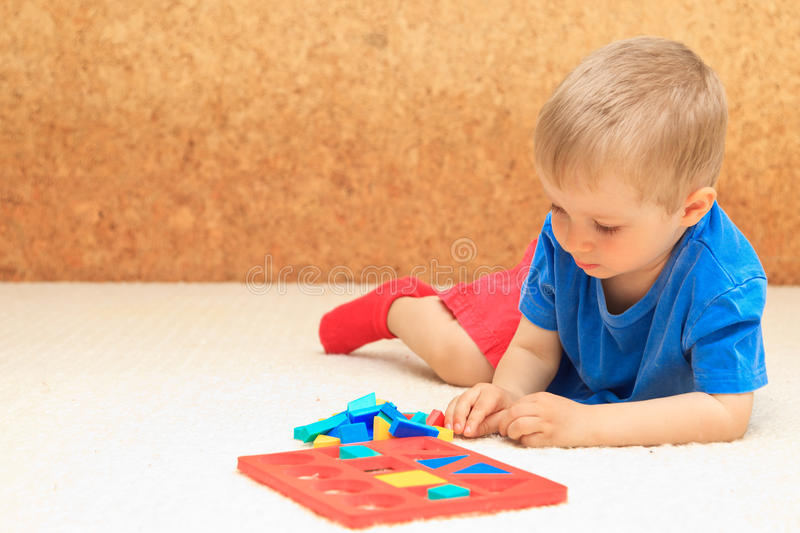 Little boy learning shapes royalty free stock photos