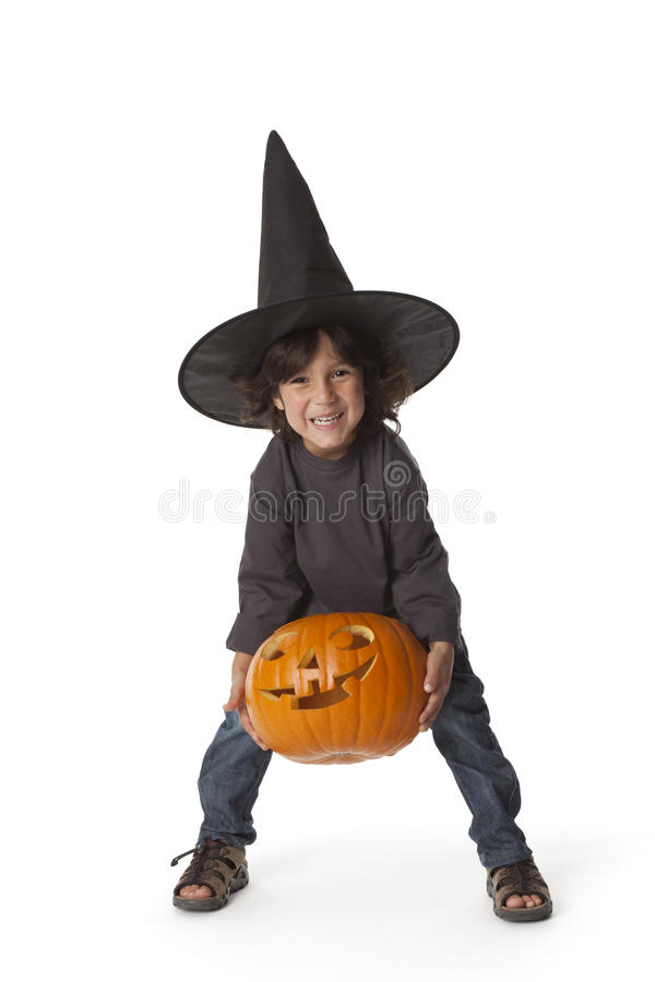 Little Boy Is Lifting A Halloween Pumpkin Royalty Free Stock Photo
