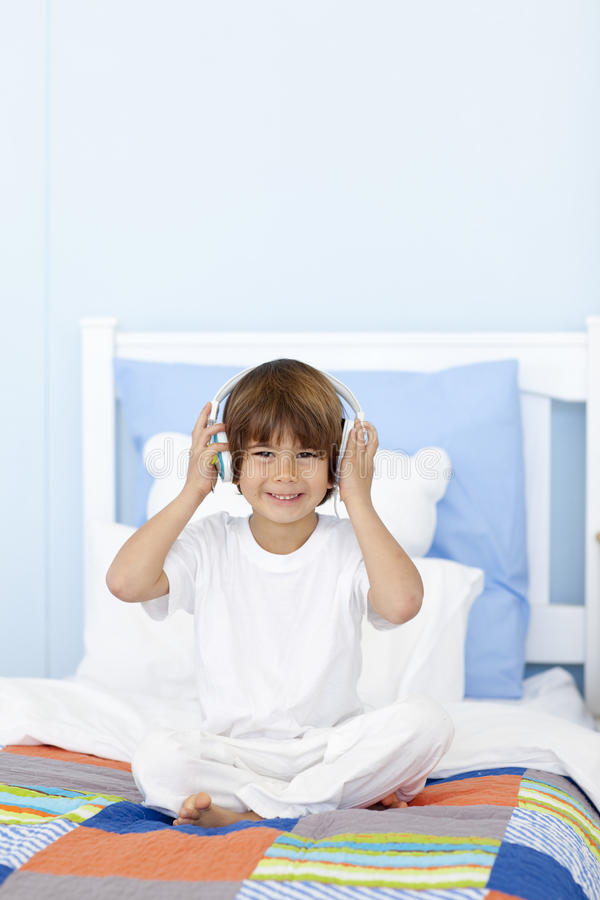 Download Little Boy Listening To Music In His Bed Stock Photo - Image: 11541604