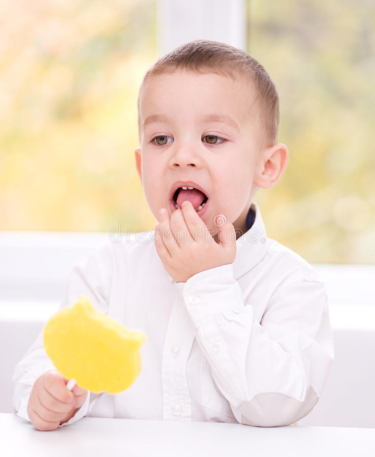 Little boy with lollipop royalty free stock images