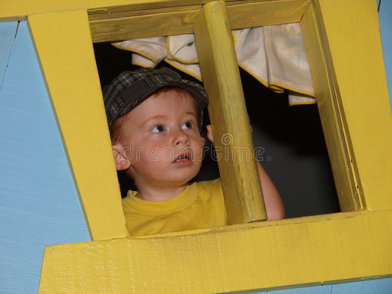 Download Little Boy Lookinf Out Window 48 Stock Image - Image: 10370687