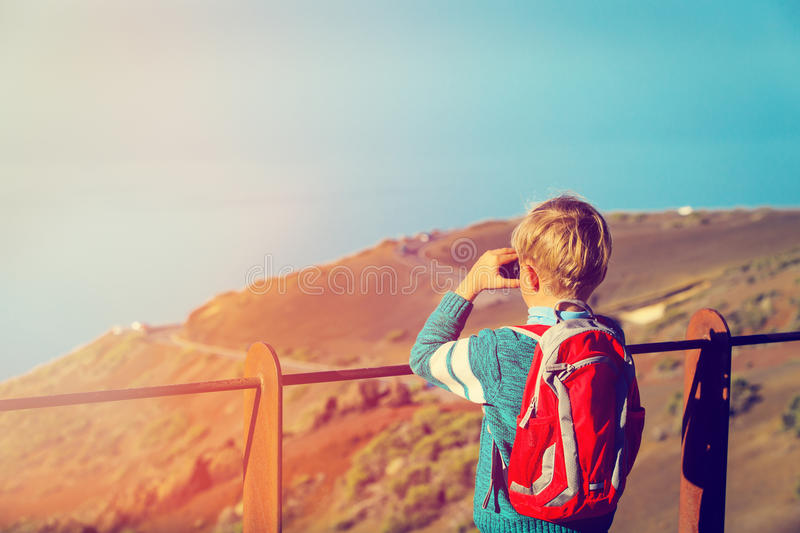 Little boy looking at beautiful view while travel in mountains royalty free stock photos