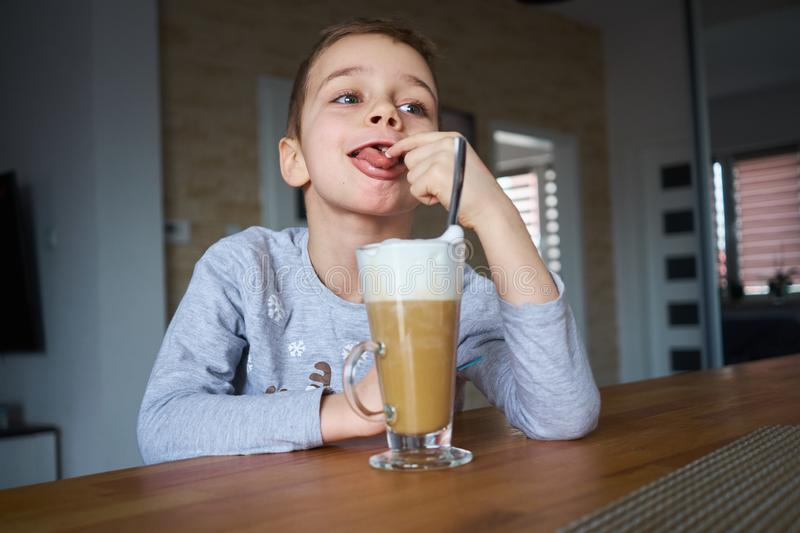 The little boy is looking at coffee royalty free stock photos