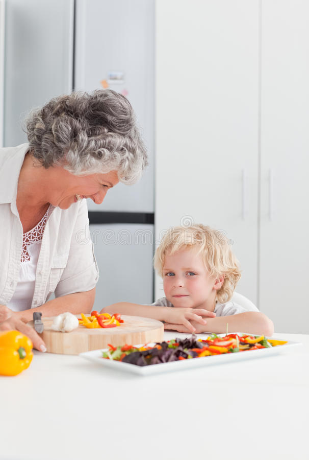 Little Boy Looking At His Grandmother Stock Image