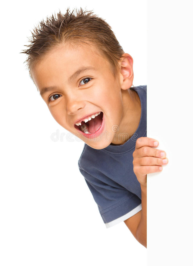 Little boy is looking out from the blank banner. Isolated over white stock images