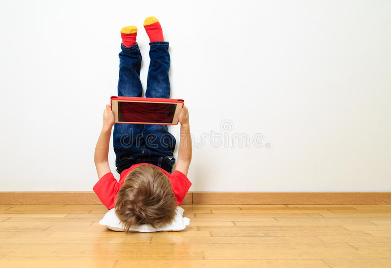 Little boy looking at touch pad stock photo