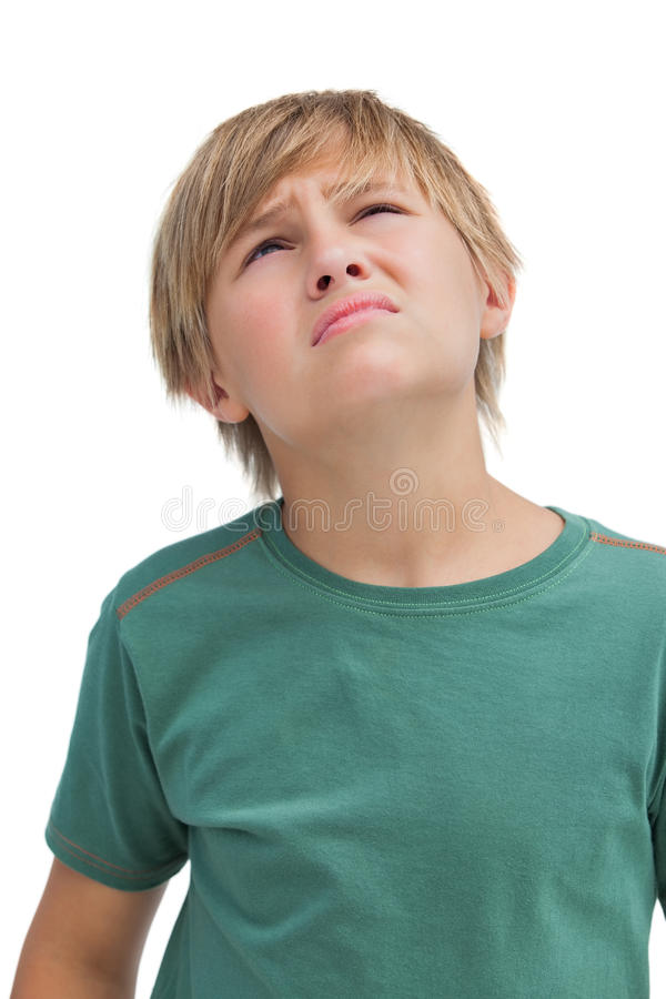 Little boy looking up and thinking stock image