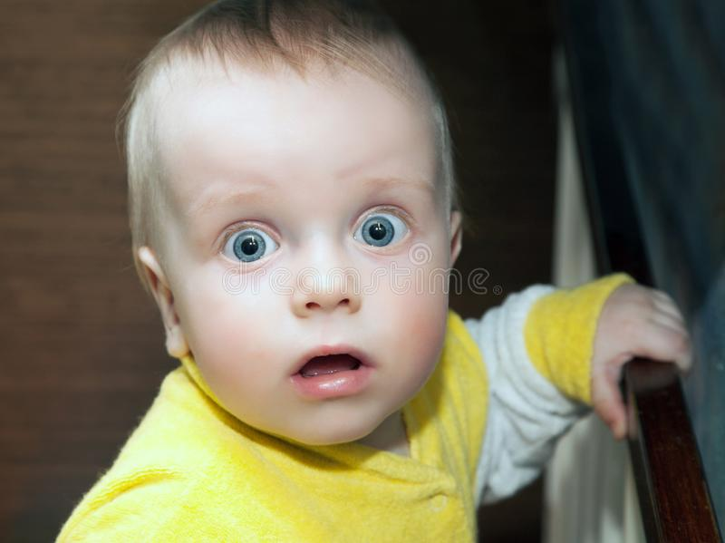 Little boy looks with a frightened. Look into the camera. close-up royalty free stock photography