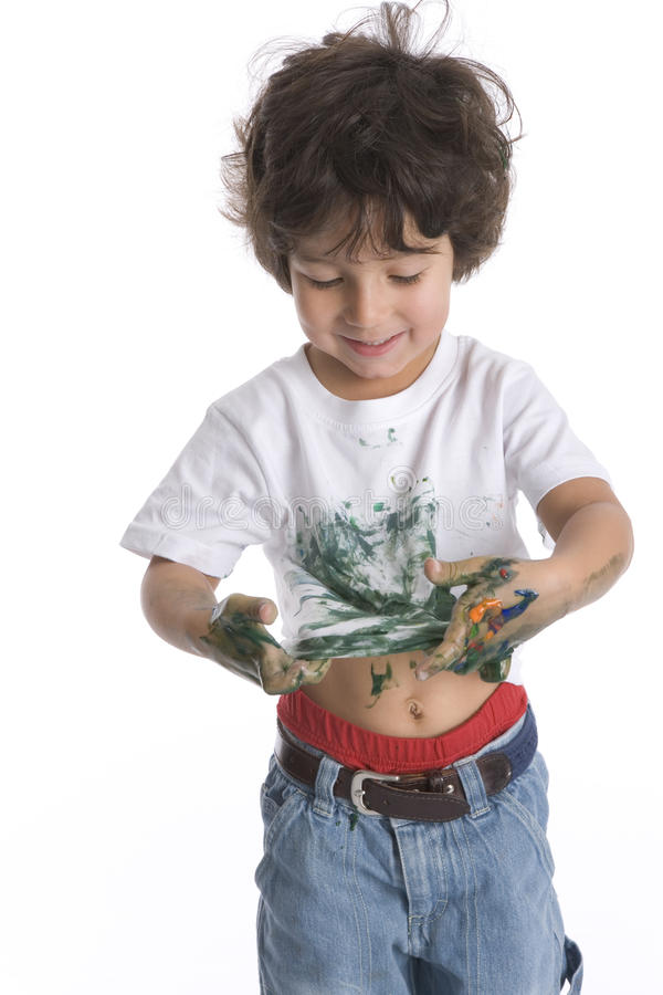 Little Boy Looks At His Shirt Full Of Green Paint stock photography