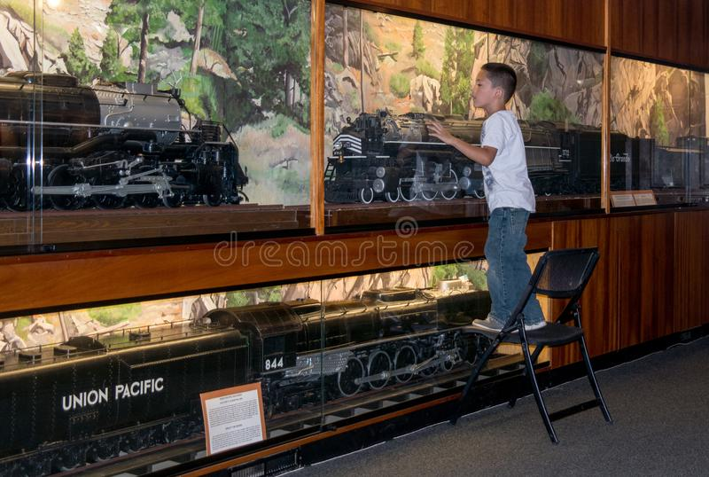Little boy in love with model trains. September 2017 Golden CO USA, , a excited little boy gazes at the model trains on display at the Golden train Museum stock photo