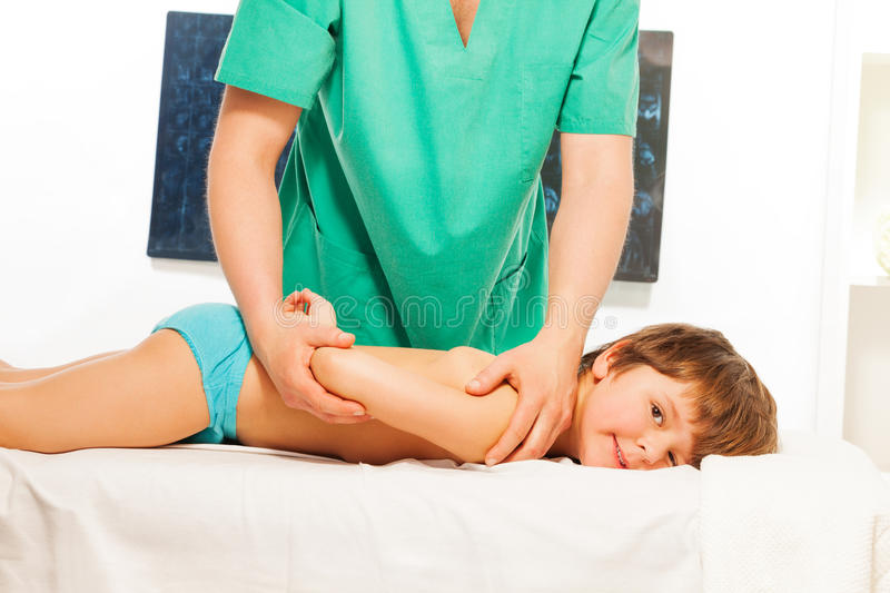 Little boy lying at the massage couch royalty free stock images