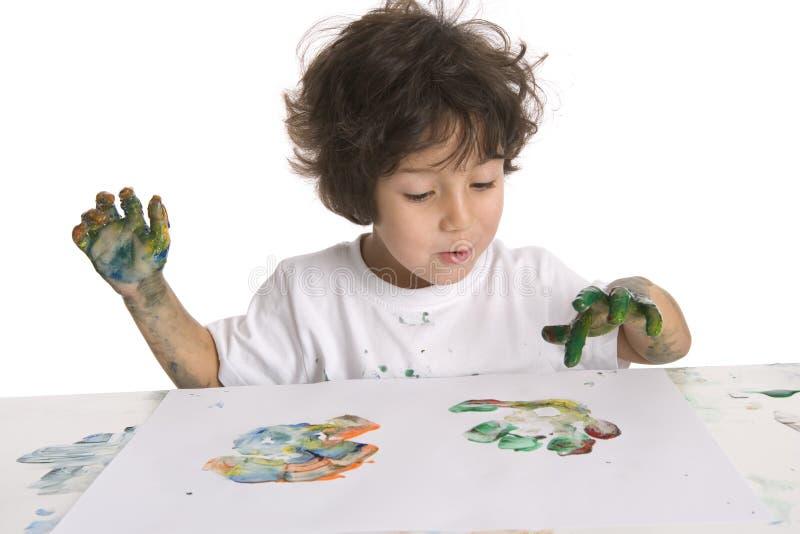 Little Boy maakt het Schilderen van de Vinger stock foto's