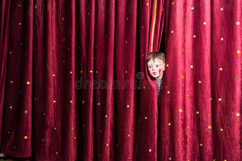 Little boy in makeup waiting for his acting cue stock photo