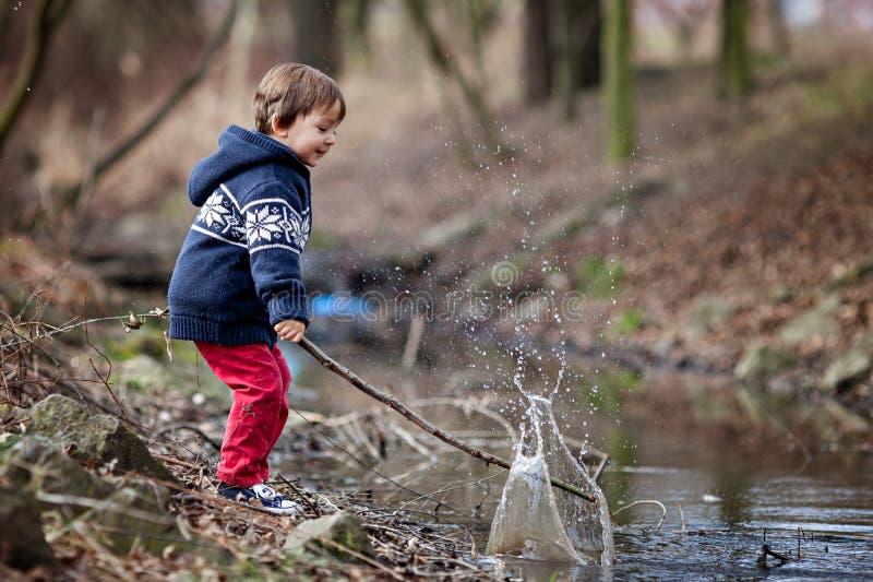 Download Little Boy, Making Big Splash On A Pond Stock Image - Image: 39325045