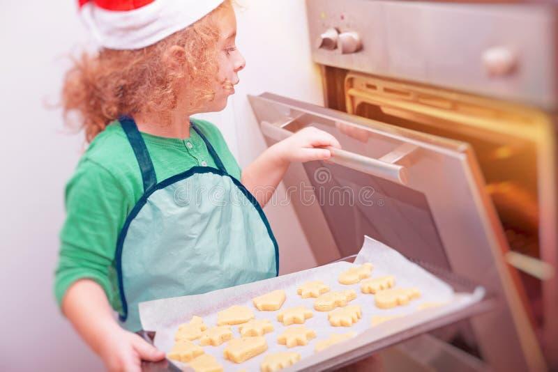 Little boy making Christmas cookies stock image