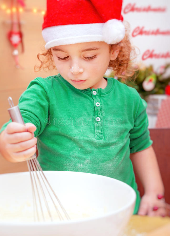 Little boy making Christmas cookies stock images