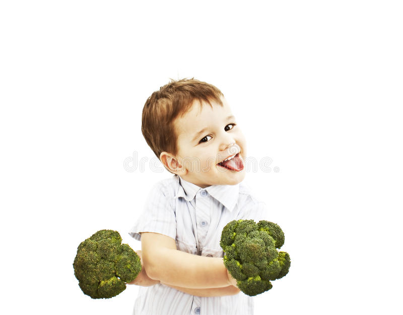 Little boy making funny face with broccoli
