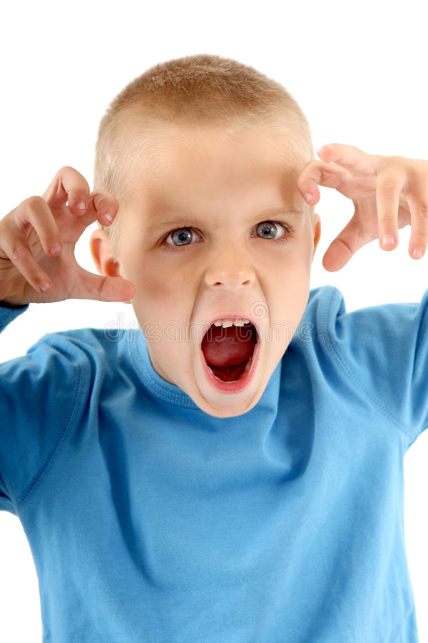 Little boy making a silly monster face royalty free stock images