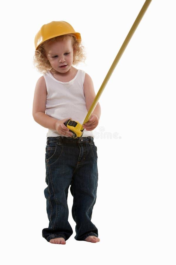 Little boy measuring royalty free stock image