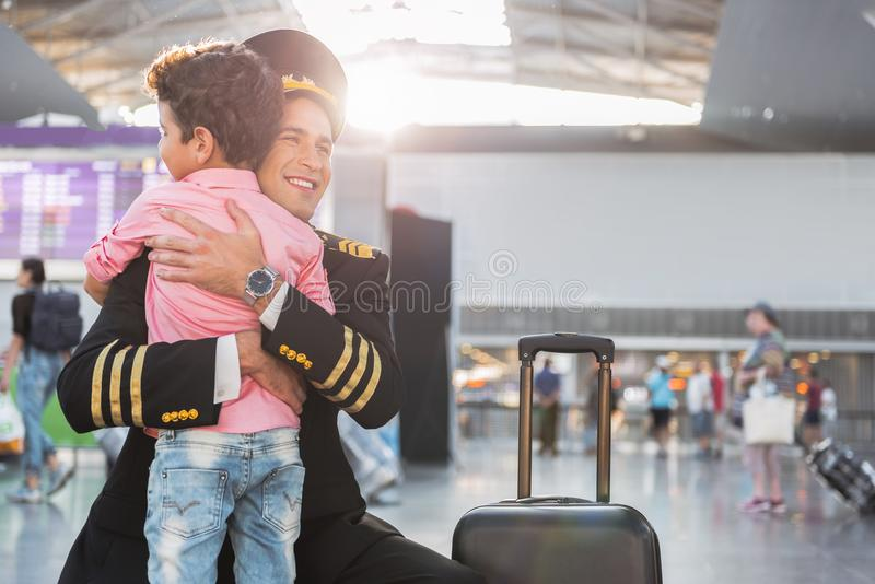 Little boy meeting father-airman in airport royalty free stock photography