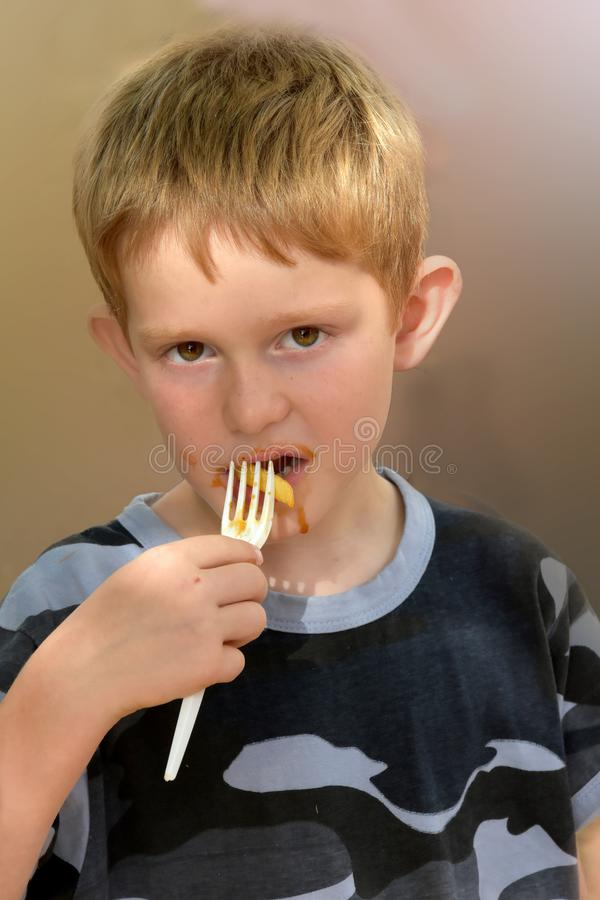 Young boy eating french fries royalty free stock photo