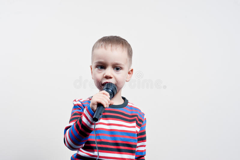 Little boy, microphone stock images