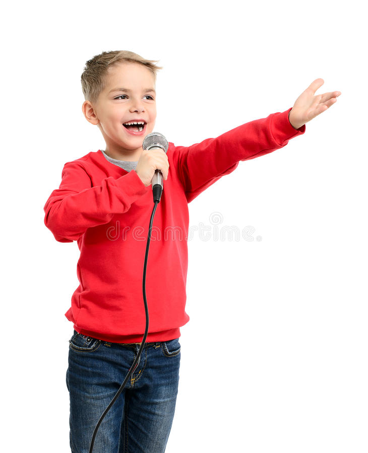 Little boy with microphone sings a song stock photo