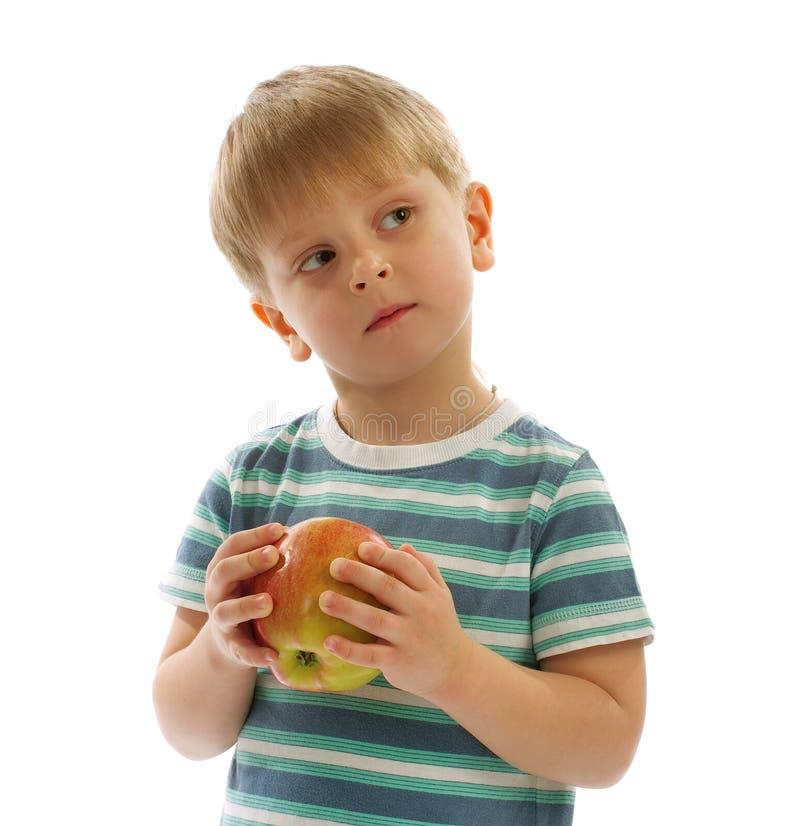 Little Boy mit Apple lizenzfreie stockfotos