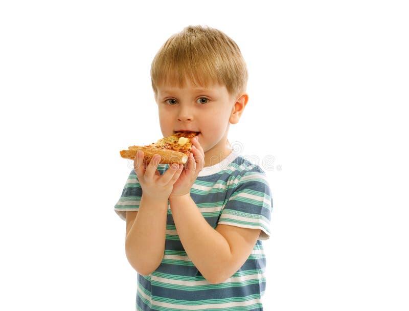 Little Boy mit Pizza lizenzfreie stockfotos
