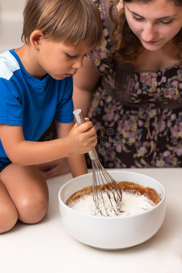 Little boy mixing pie dough royalty free stock images