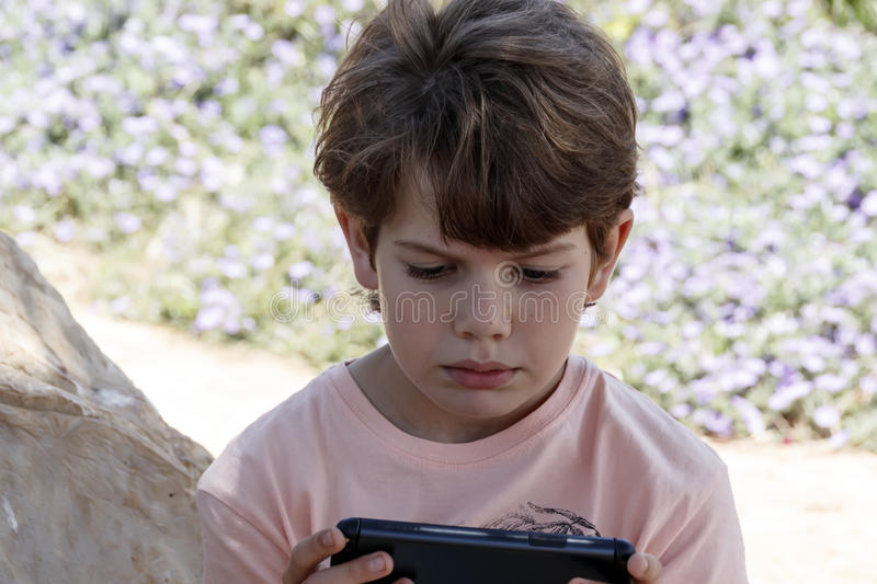 Little boy with mobile device royalty free stock photos