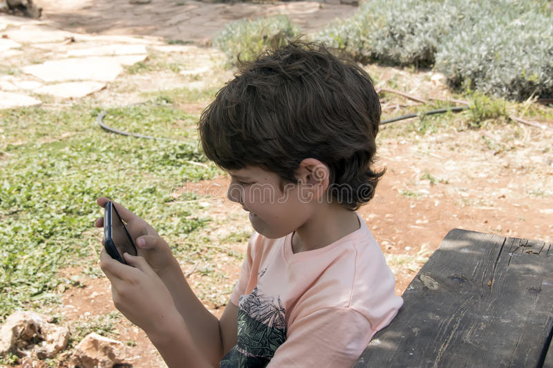 Little boy with mobile device royalty free stock image
