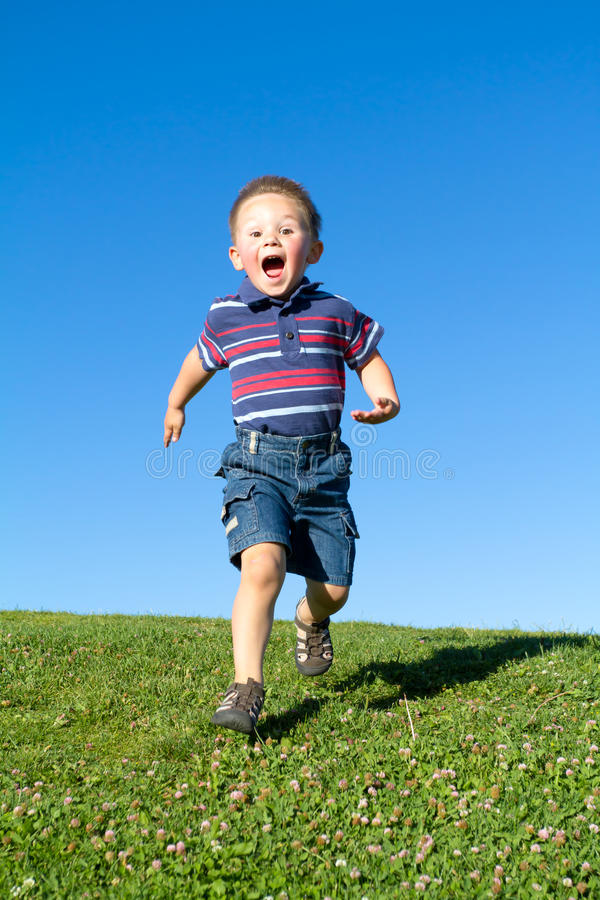 Download Little boy in move stock photo. Image of sporting, scream - 18088832
