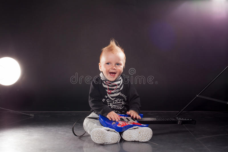 Download Little Boy Musician Playing Rock Music On The Guitar Stock Image - Image of person, happy: 95247067