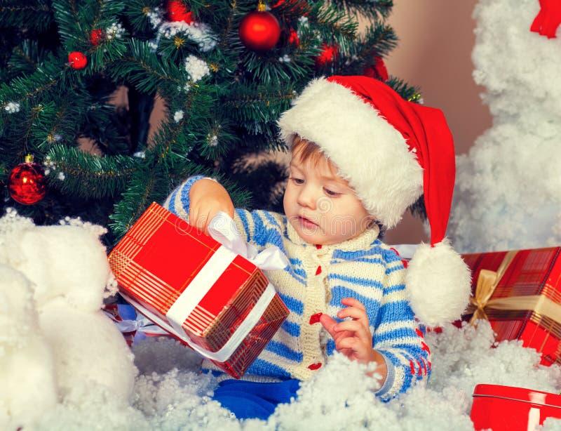 Little boy near decorated Christmas tree royalty free stock photo