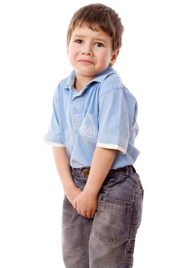 Little boy need a pee. Isolated on white royalty free stock photography